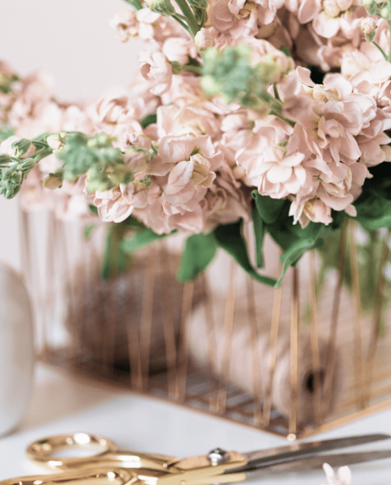 gold scissors and basket of blush roses
