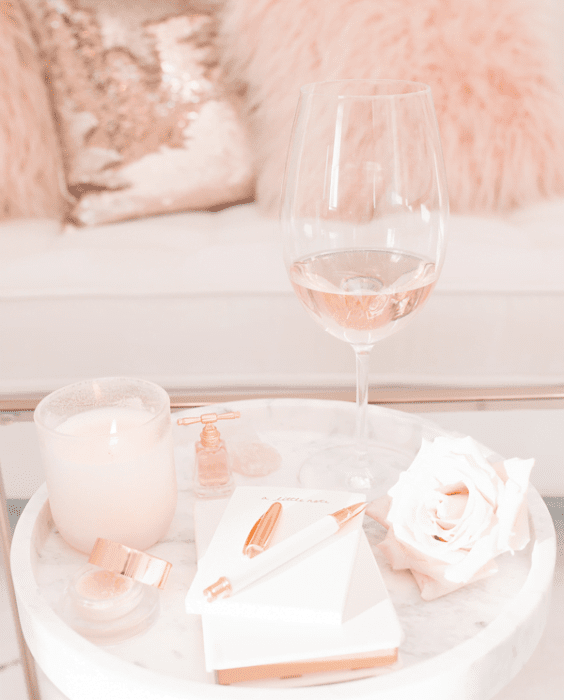 Soft pink candle and wine