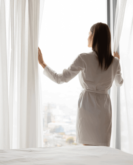 Growing pains concept woman looking out window